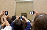 Mona Lisa being photographed